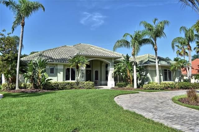 3868 Hunters Isle Dr, Orlando, FL 32837 (MLS #S5020644) :: Bustamante Real Estate
