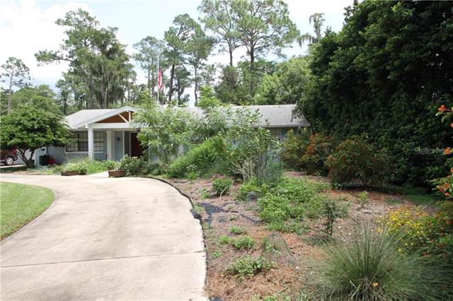 14030 Lake Price Drive, Orlando, FL 32826 (MLS #S5022046) :: The Duncan Duo Team