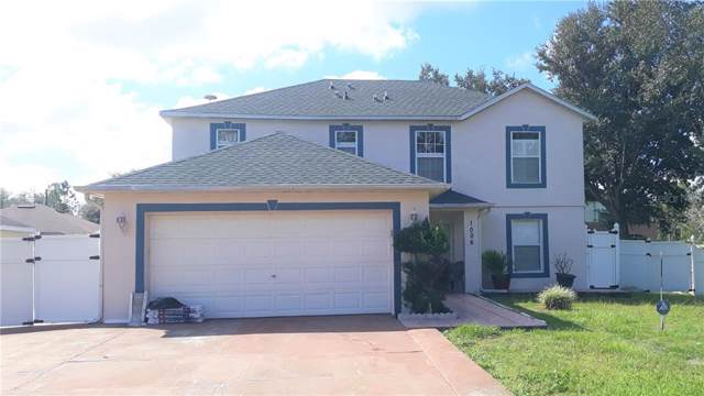 1006 Pantheon Drive, Kissimmee, FL 34759 (MLS #S5024724) :: NewHomePrograms.com LLC