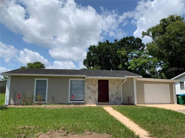 994 Saxon Boulevard, Deltona, FL 32725 (MLS #S5026266) :: Homepride Realty Services