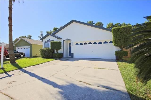 2226 Justin Avenue, Orlando, FL 32826 (MLS #S5026357) :: GO Realty