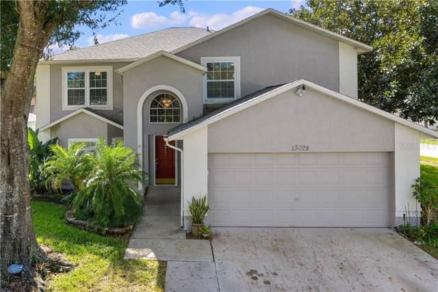 13028 Bellerive Lane, Orlando, FL 32828 (MLS #S5026721) :: Carmena and Associates Realty Group