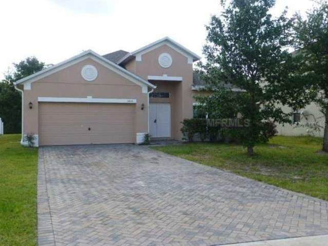 2622 Eagle Canyon Drive N, Kissimmee, FL 34746 (MLS #S5030857) :: Rabell Realty Group
