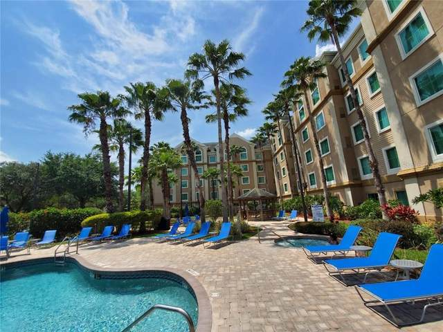8303 Palm Parkway #213, Orlando, FL 32836 (MLS #S5032917) :: Positive Edge Real Estate