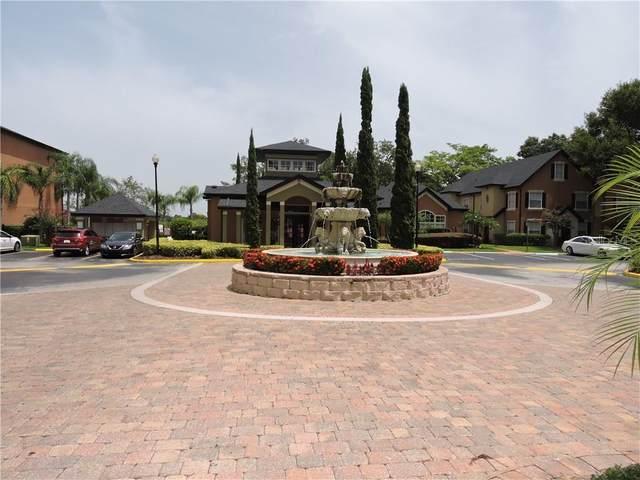 6017 Westgate Drive #912, Orlando, FL 32835 (MLS #S5036275) :: Lockhart & Walseth Team, Realtors