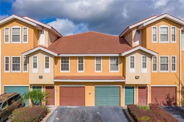12208 Wild Iris Way #106, Orlando, FL 32837 (MLS #S5041978) :: Godwin Realty Group