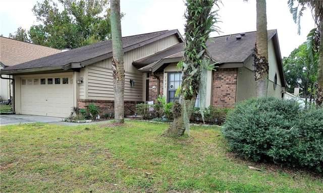 7027 Villa Estelle Drive, Orlando, FL 32819 (MLS #S5041983) :: RE/MAX Premier Properties