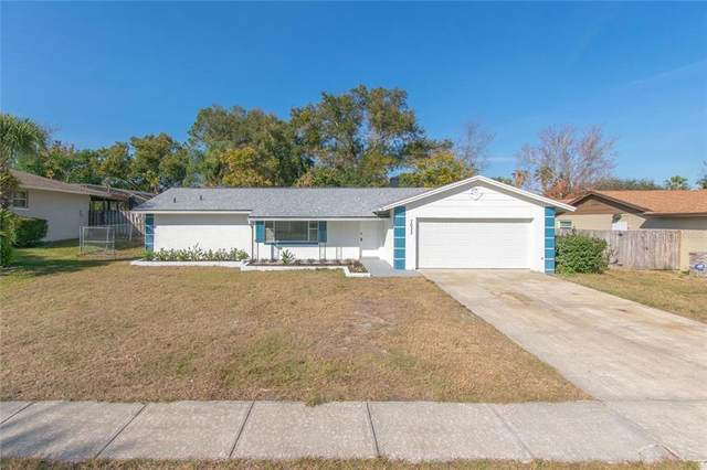 7033 Crestlake Drive, Orlando, FL 32819 (MLS #S5045492) :: Visionary Properties Inc