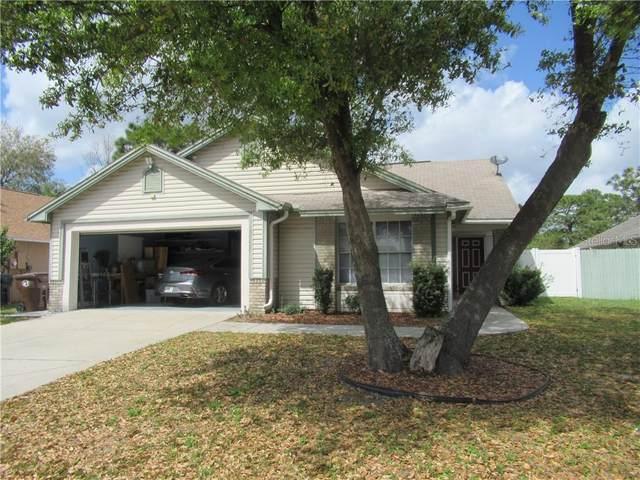 2964 Oaktree Drive, Kissimmee, FL 34744 (MLS #S5047431) :: The Light Team
