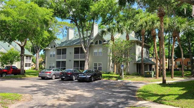 6070 Westgate Drive #202, Orlando, FL 32835 (MLS #S5050521) :: Positive Edge Real Estate