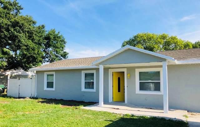 14017 Newcomb Avenue, Orlando, FL 32826 (MLS #S5050786) :: RE/MAX Premier Properties