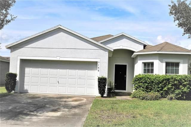 3166 Queen Alexandria Drive, Kissimmee, FL 34744 (MLS #S5056555) :: Godwin Realty Group