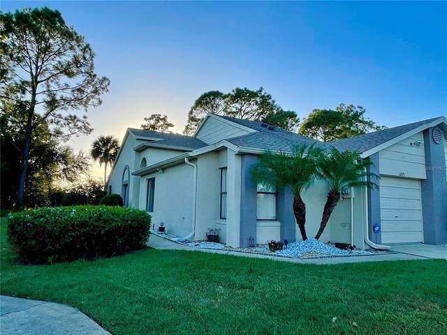 12225 Augusta Woods Circle, Orlando, FL 32824 (MLS #S5056985) :: Pepine Realty