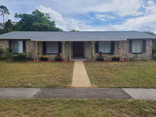 6148 Hardrock Circle, Orlando, FL 32819 (MLS #S5058246) :: Kreidel Realty Group, LLC