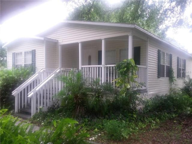 6811 Ravenwood Street, Wesley Chapel, FL 33544 (MLS #T2889866) :: Arruda Family Real Estate Team
