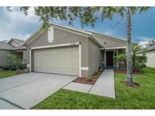 31139 Tagus Loop, Wesley Chapel, FL 33545 (MLS #T2890599) :: Cartwright Realty