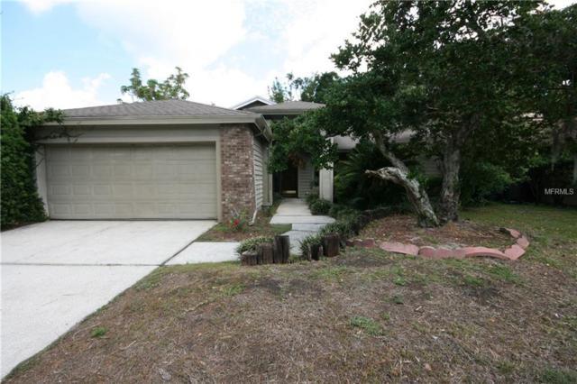 14635 Village Glen Circle, Tampa, FL 33618 (MLS #T3101532) :: Delgado Home Team at Keller Williams