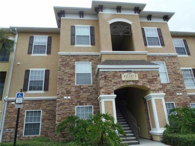 10203 Courtney Palms Boulevard #101, Tampa, FL 33619 (MLS #T3103585) :: Arruda Family Real Estate Team
