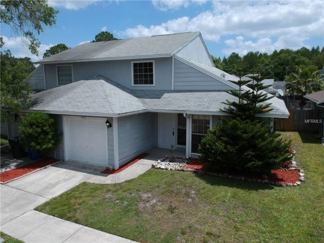 4510 Cedarwood Village Drive, Tampa, FL 33624 (MLS #T3104635) :: The Duncan Duo Team