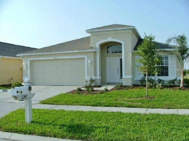 31147 Whinsenton Drive, Wesley Chapel, FL 33543 (MLS #T3119686) :: The Light Team