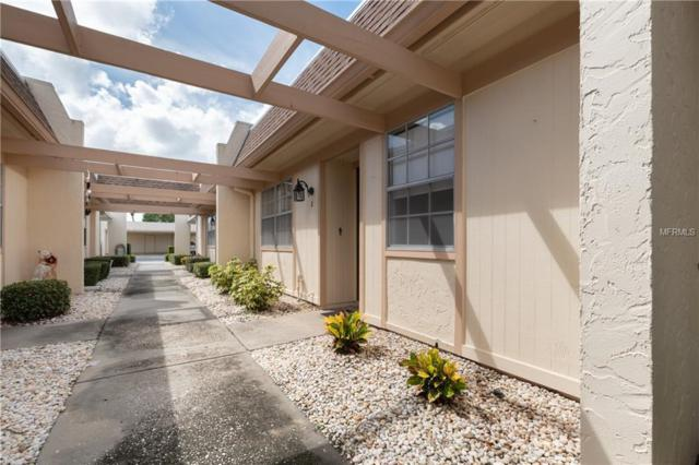 11211 Carriage Hill Drive #2, Port Richey, FL 34668 (MLS #T3128803) :: The Duncan Duo Team