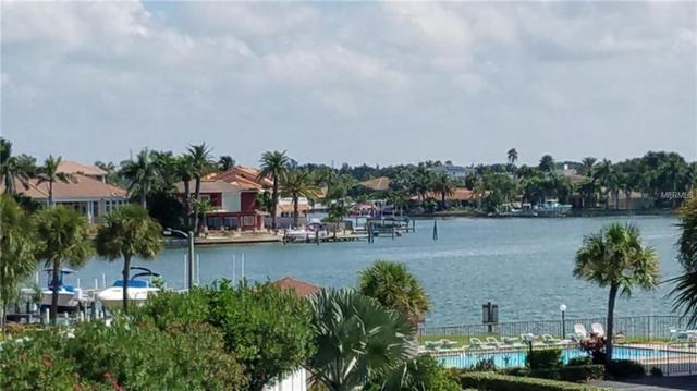 8711 Blind Pass Road 207A, St Pete Beach, FL 33706 (MLS #T3129218) :: The Duncan Duo Team