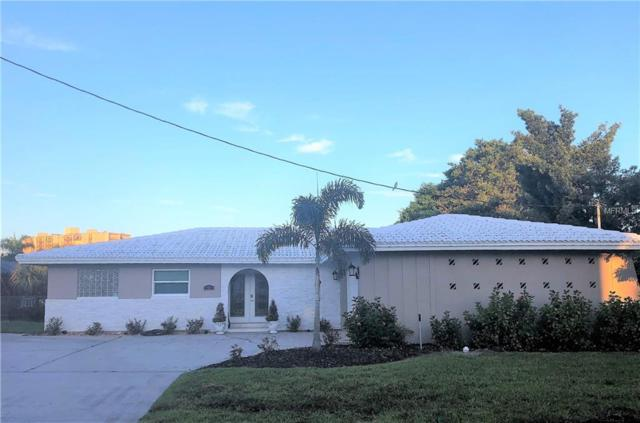 106 Midway Island, Clearwater Beach, FL 33767 (MLS #T3130204) :: The Light Team