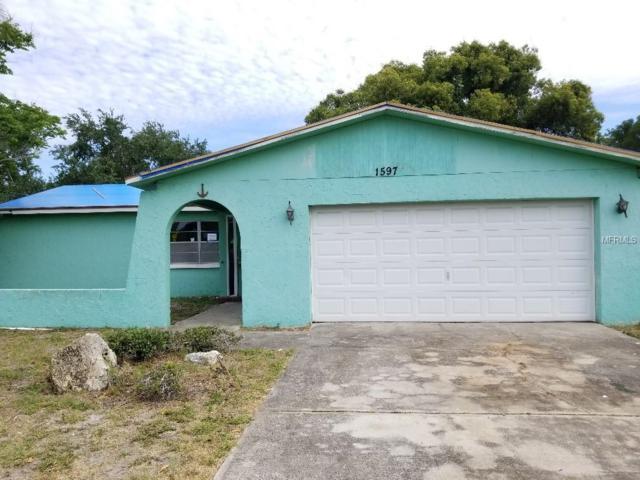 1597 54TH Avenue S, St Petersburg, FL 33705 (MLS #T3175873) :: Lovitch Realty Group, LLC