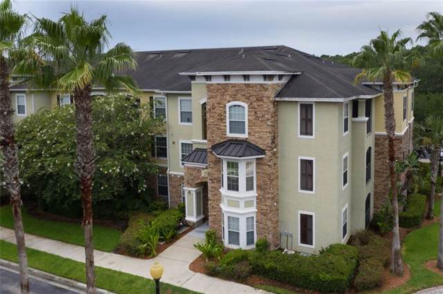 9918 Courtney Palms Boulevard #202, Tampa, FL 33619 (MLS #T3185865) :: Jeff Borham & Associates at Keller Williams Realty