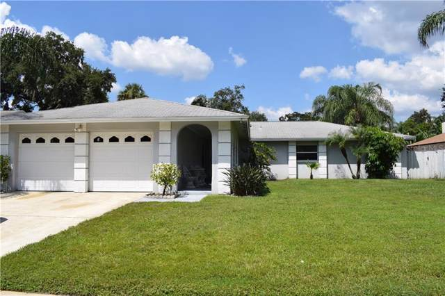 8017 Jackson Springs Road, Tampa, FL 33615 (MLS #T3198329) :: Griffin Group
