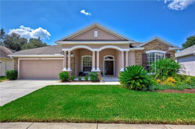 7705 Whispering Wind Drive, Land O Lakes, FL 34637 (MLS #T3199384) :: Delgado Home Team at Keller Williams
