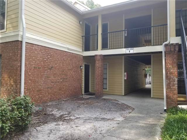 8605 Mallard Reserve Drive #102, Tampa, FL 33614 (MLS #T3200108) :: Lock & Key Realty