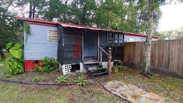 19403 Wildwood Drive, Brooksville, FL 34601 (MLS #T3206015) :: The Duncan Duo Team