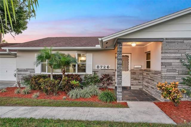 8726 Palisades Drive, Tampa, FL 33615 (MLS #T3211400) :: Delgado Home Team at Keller Williams