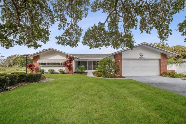 14092 Leeward Drive, Seminole, FL 33776 (MLS #T3214341) :: Cartwright Realty