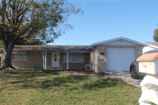 8911 Tropical Palm Way, Port Richey, FL 34668 (MLS #T3214673) :: The Duncan Duo Team