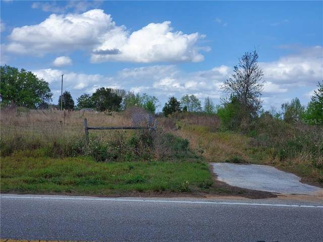 9707 E Dewey Robbins Road, Howey in the Hills, FL 34737 (MLS #T3233246) :: Griffin Group