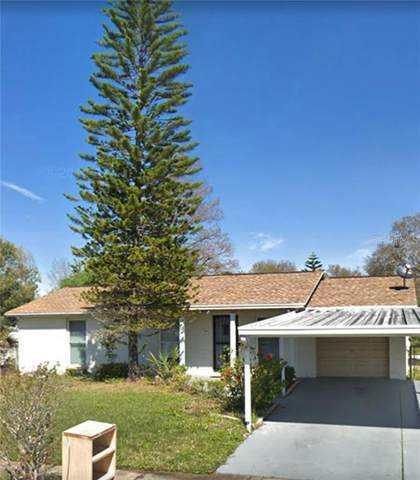 7910 Woodglen Cir, Tampa, FL 33615 (MLS #T3246553) :: Cartwright Realty