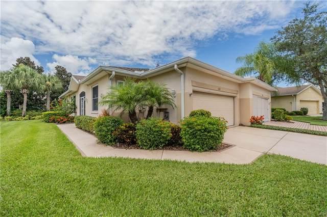 1305 Fairway Greens Drive, Sun City Center, FL 33573 (MLS #T3250532) :: Frankenstein Home Team