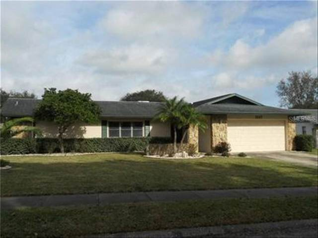 1037 Ridge Drive, Palm Harbor, FL 34683 (MLS #T3251275) :: Homepride Realty Services