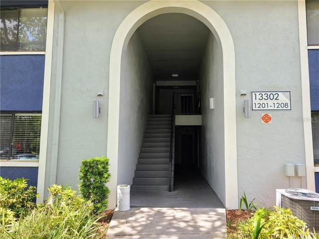 13302 Whispering Palms Place SW #1207, Largo, FL 33774 (MLS #T3252511) :: Cartwright Realty