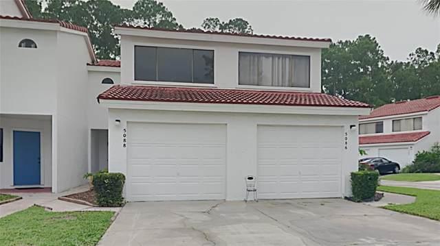 5088 Ernst Court #36, Orlando, FL 32819 (MLS #T3320572) :: The Duncan Duo Team