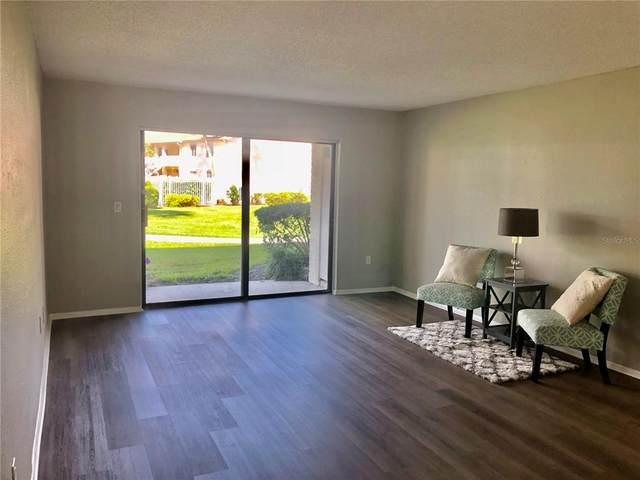 7918 Kosi Palm Place #101, Tampa, FL 33615 (MLS #T3330948) :: The Nathan Bangs Group
