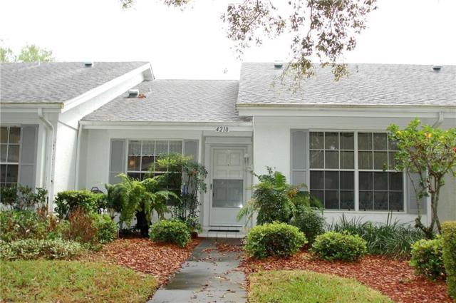 4210 Edgewood Drive, Holiday, FL 34691 (MLS #U7852492) :: Griffin Group