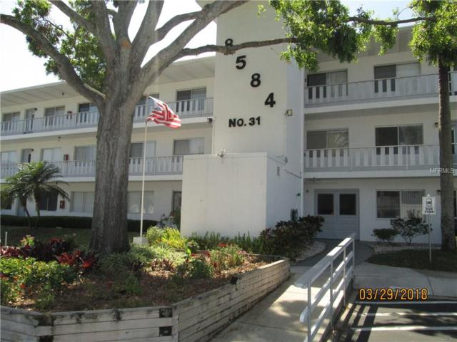 8584 111TH Street #104, Seminole, FL 33772 (MLS #U7853290) :: The Duncan Duo Team