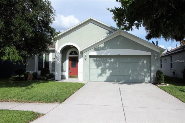 4252 Tarkington Drive, Land O Lakes, FL 34639 (MLS #U8001554) :: Cartwright Realty
