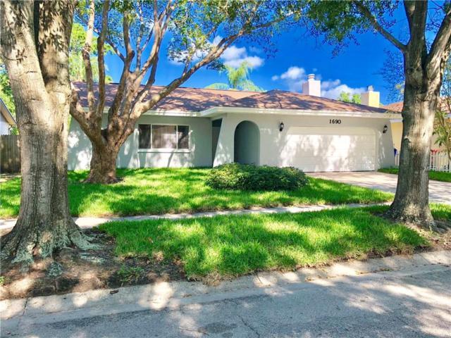 1690 E Orangecrest Avenue, Palm Harbor, FL 34683 (MLS #U8005285) :: Jeff Borham & Associates at Keller Williams Realty