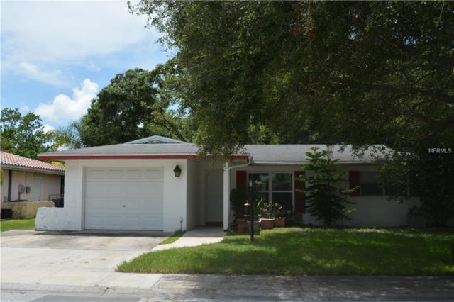 422 Maplewood Drive, Oldsmar, FL 34677 (MLS #U8011401) :: Lock and Key Team