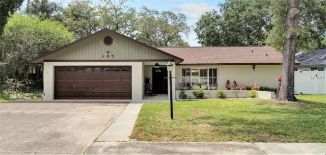 945 Winding Oaks Drive, Palm Harbor, FL 34683 (MLS #U8042984) :: Delgado Home Team at Keller Williams