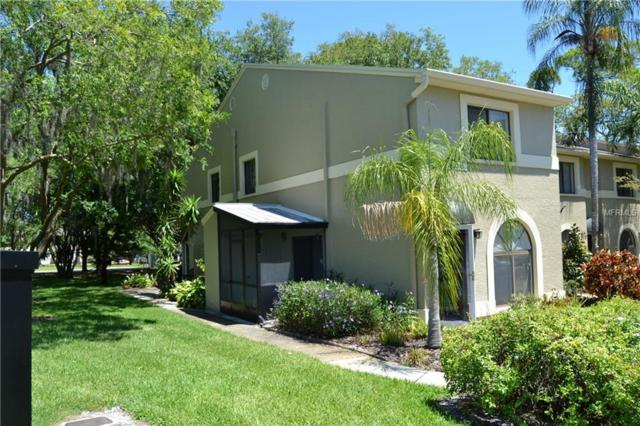 3607 Whispering Oaks Lane #402, Palm Harbor, FL 34684 (MLS #U8043027) :: The Edge Group at Keller Williams